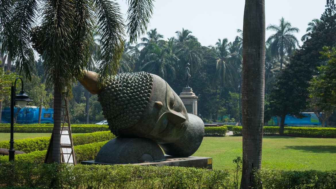 grey elephant statue on green grass field during daytime