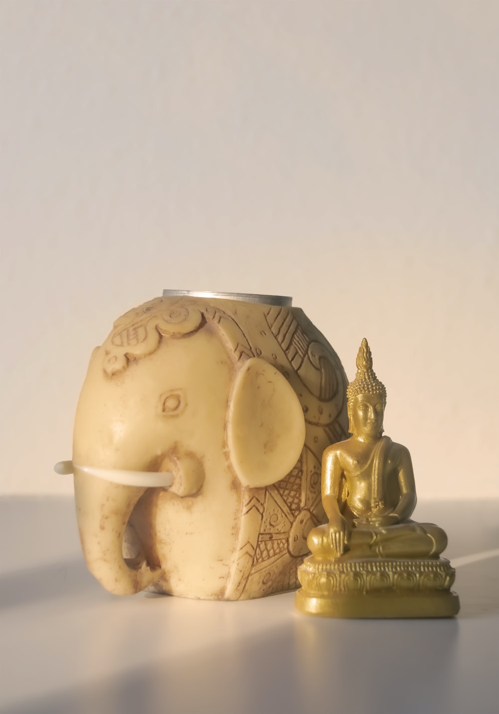 gold and white ceramic figurine