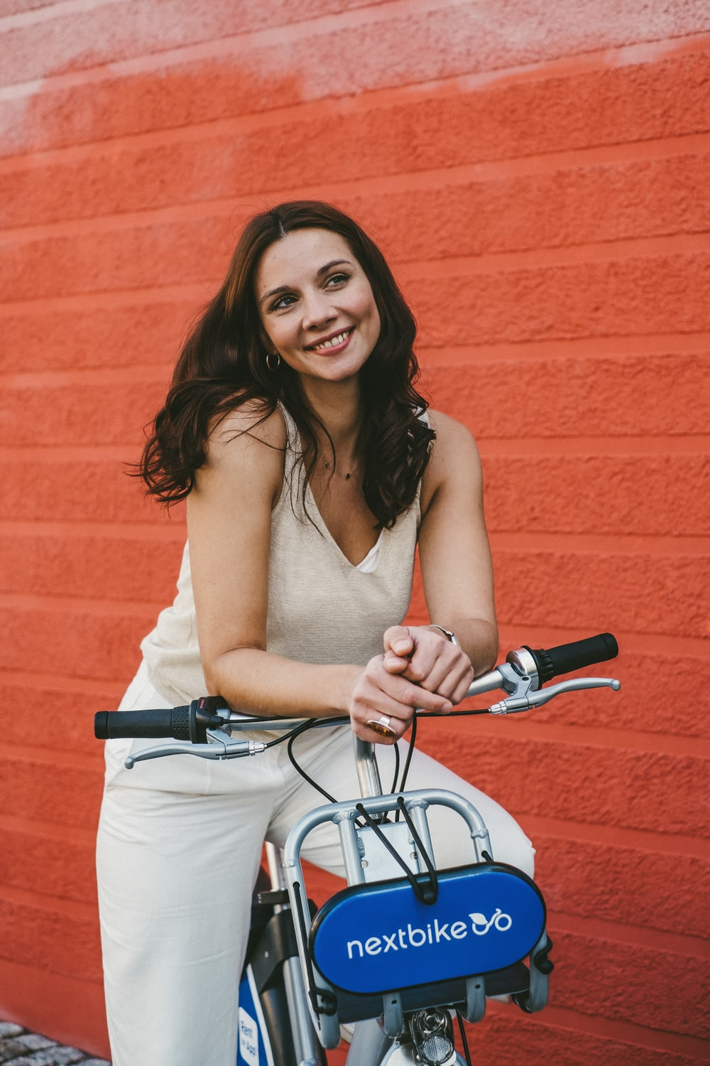woman in brown tank top riding on bicycle
