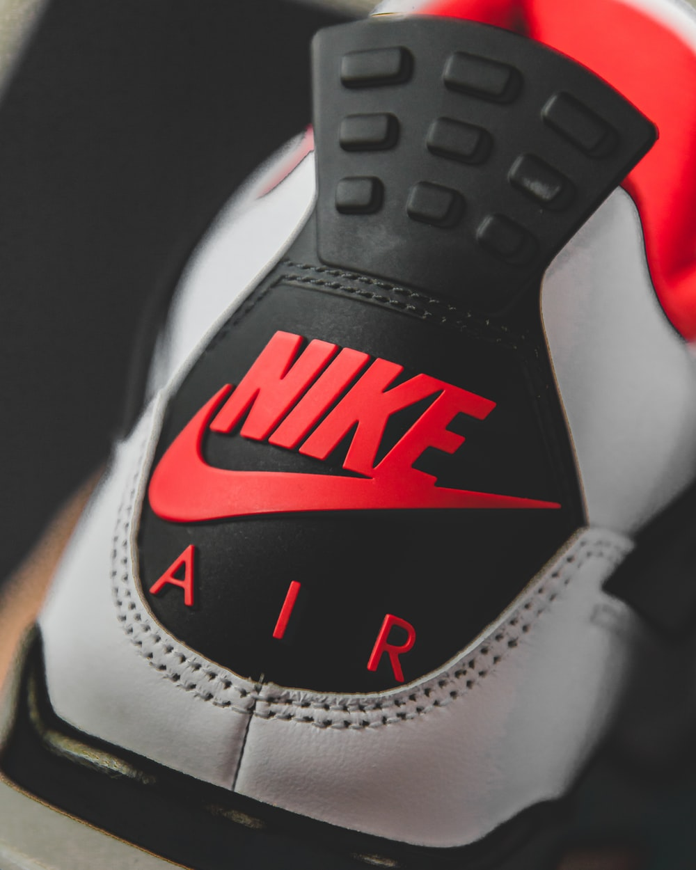 white black and red nike shoe