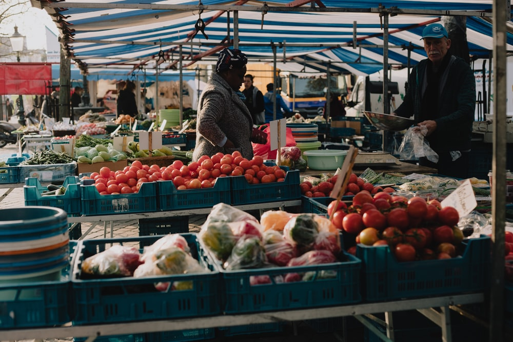 red and white fruit display on market