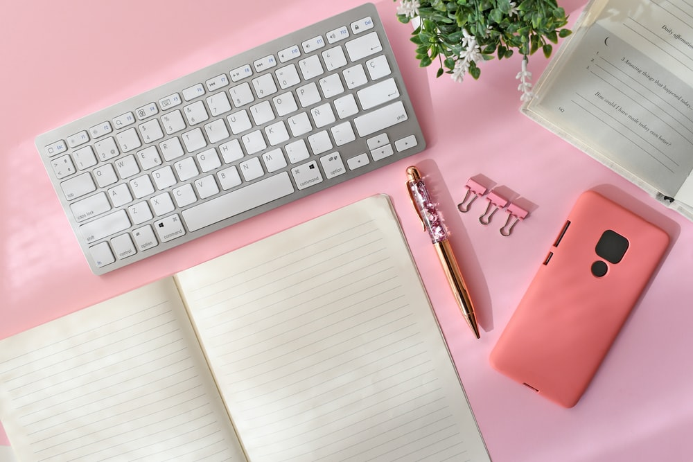 silver apple keyboard on white table