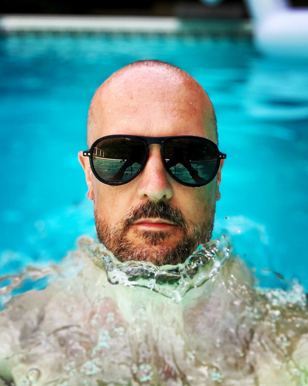 man in black sunglasses in swimming pool