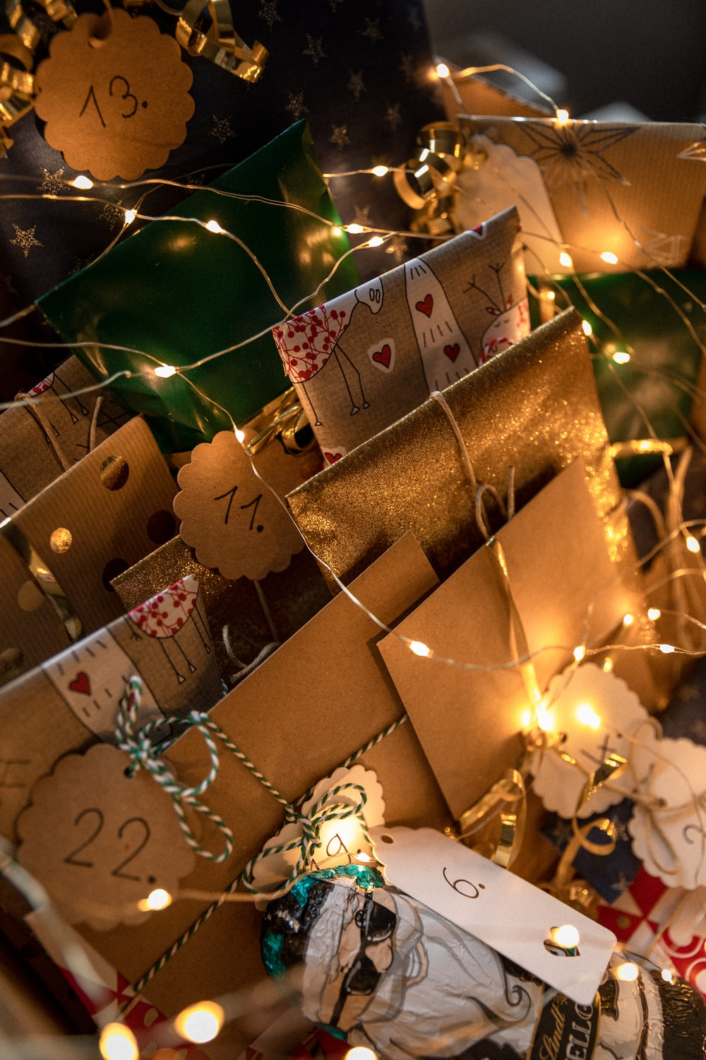 brown gift boxes with white string lights