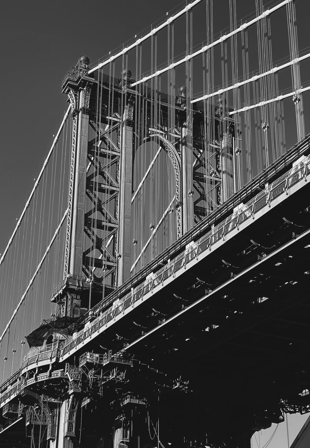 grayscale photo of bridge with cars