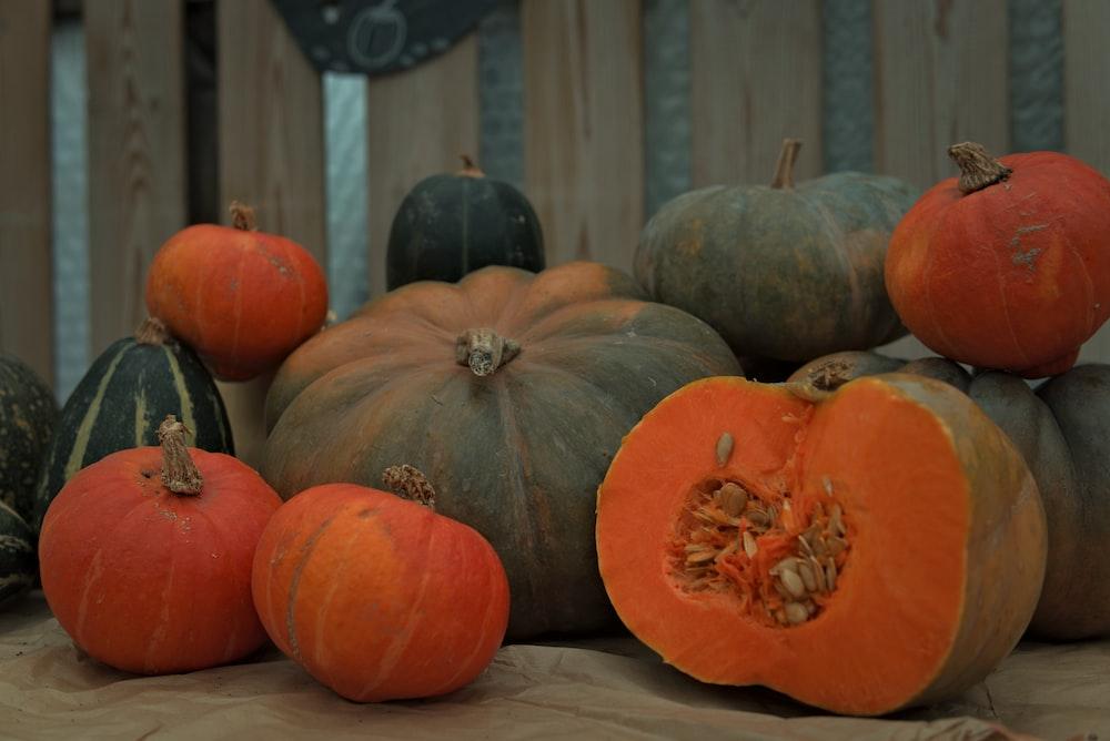 orange pumpkin on white textile