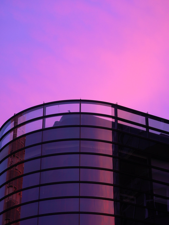 gray concrete building under pink sky