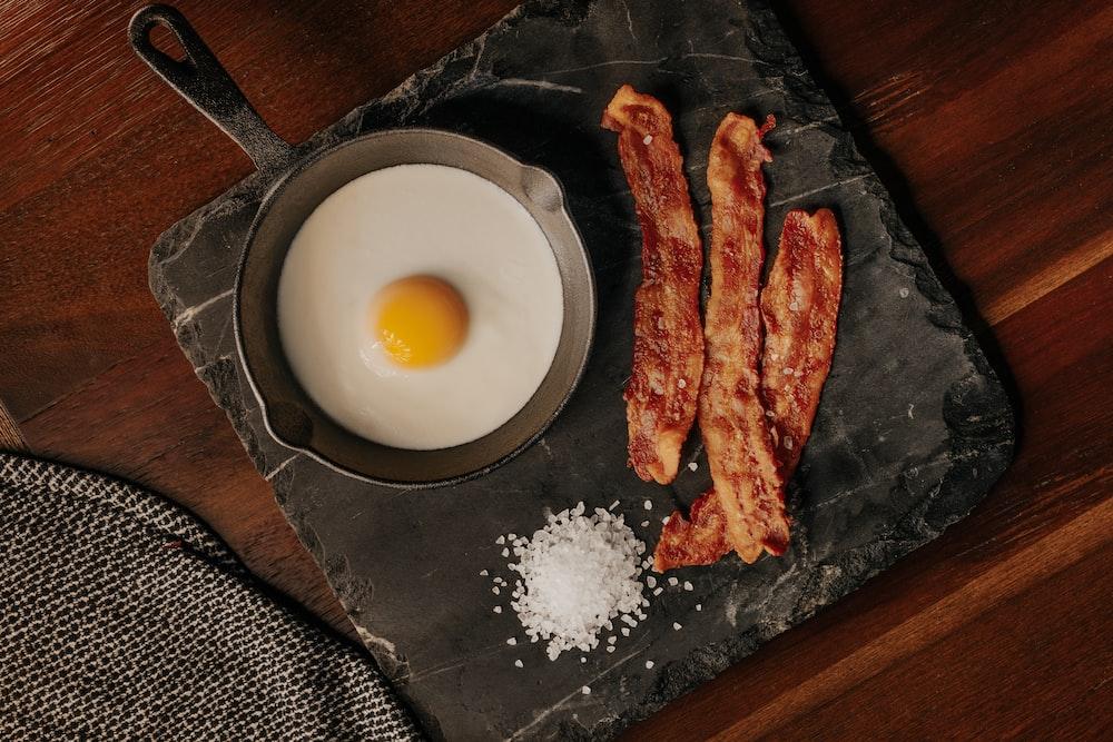 white egg on black plate
