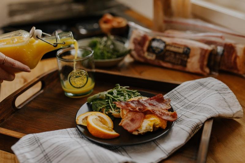 grilled meat on blue ceramic plate beside sliced lemon on brown wooden table
