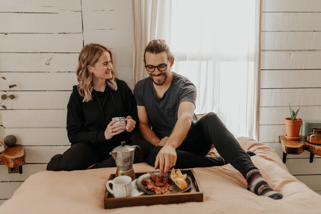 Man and Woman Sitting On Bed - unsplash