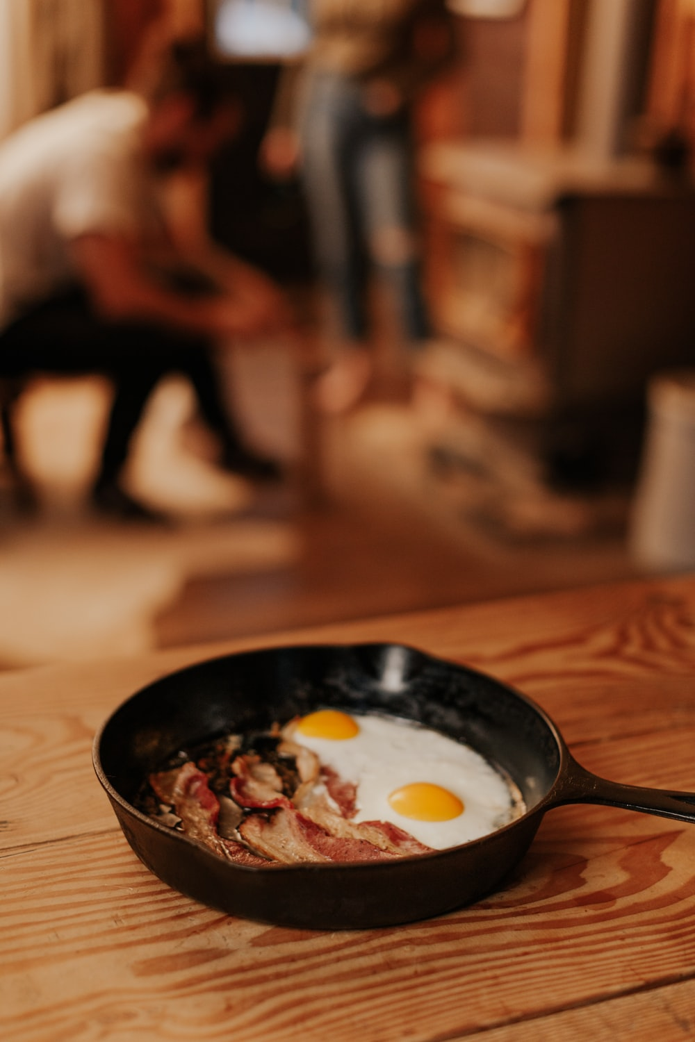 black frying pan on brown wooden table