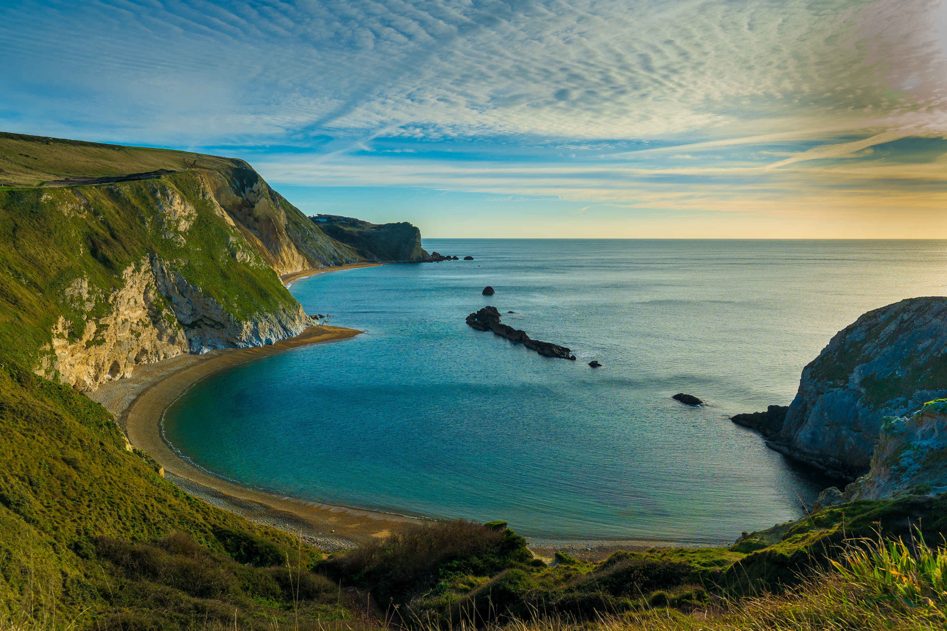 Early morning, overlooking a turquoise bay on the Dorset coast.