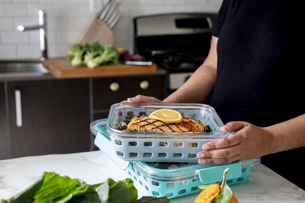 person holding tray with food
