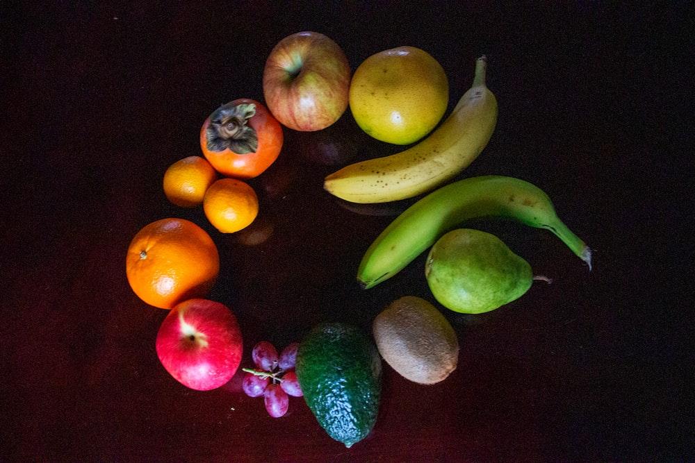 green banana orange and red apple fruits