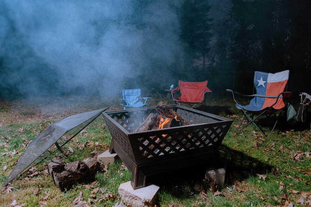 brown fire pit with fire