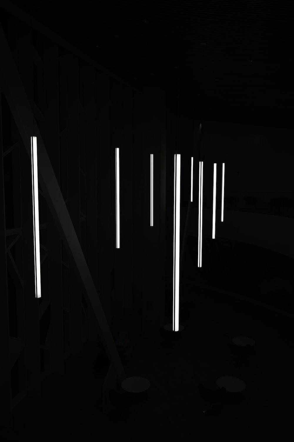 white light bulb turned on in dark room
