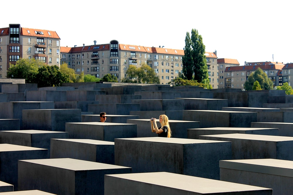 people sitting on gray concrete bench during daytime