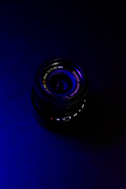 black camera lens on blue background