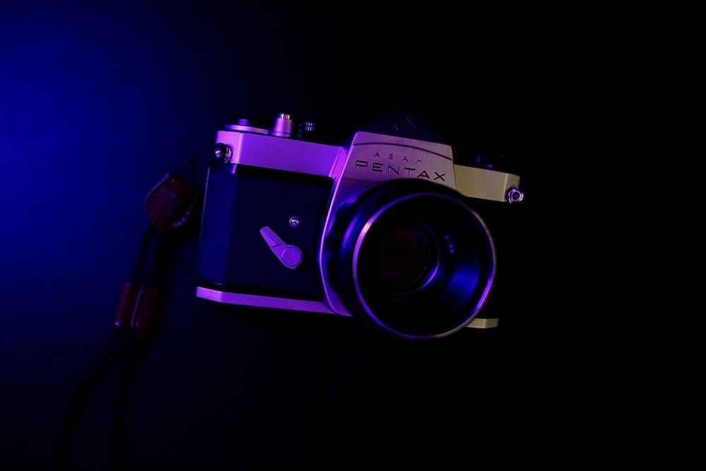 purple and black nikon dslr camera
