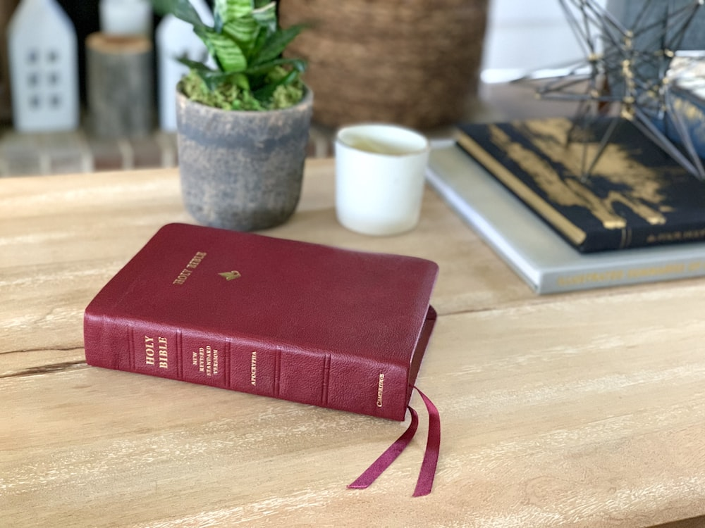 red book on brown wooden table