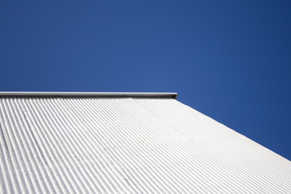 white and gray concrete building under blue sky during daytime
