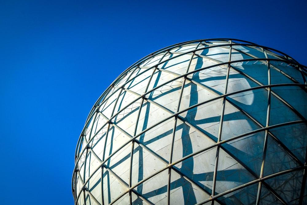 white round building under blue sky during daytime