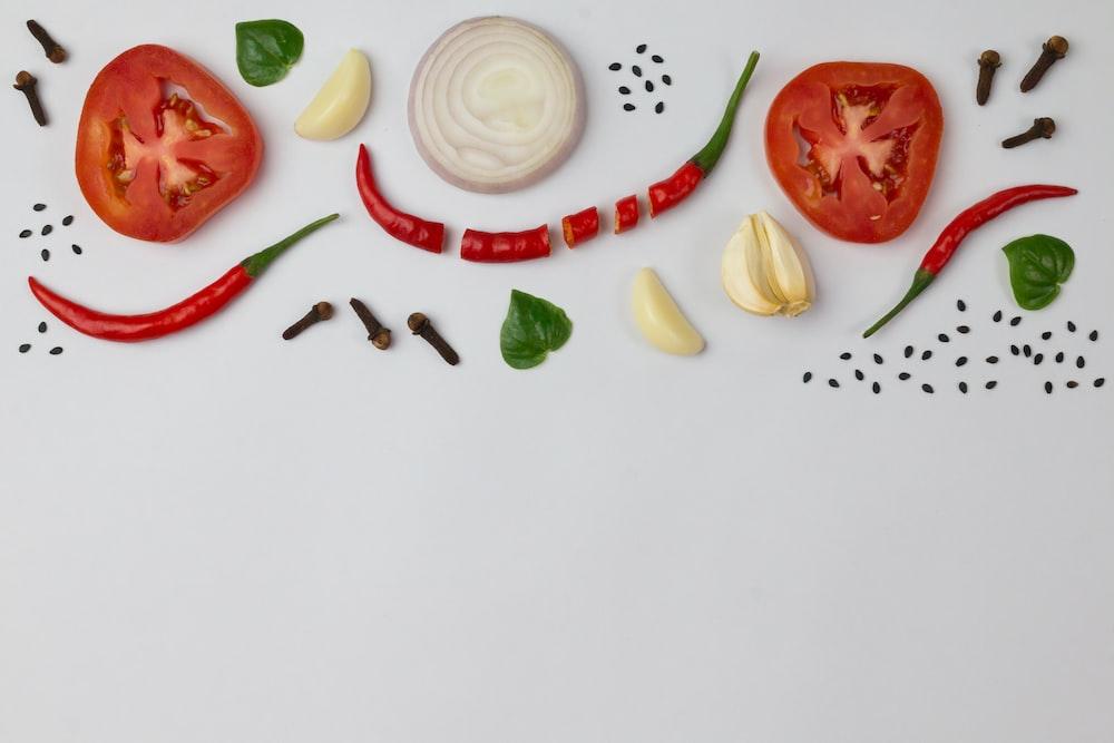 sliced tomato and sliced lemon on white ceramic plate