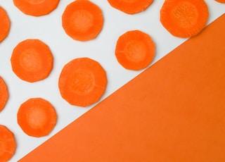 orange paper with round orange fruits