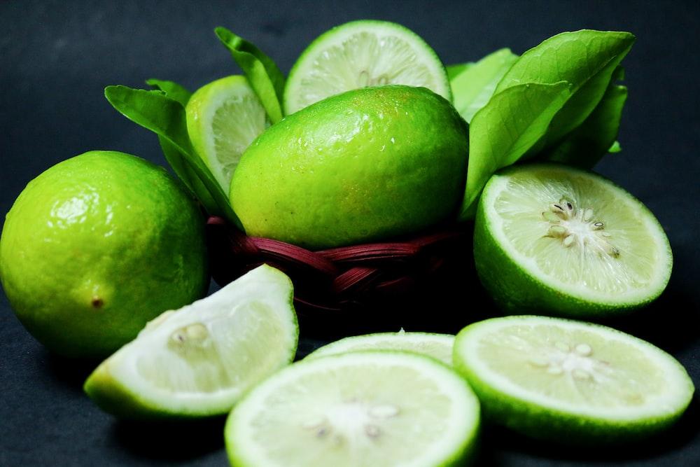 sliced green fruit on red plastic basket