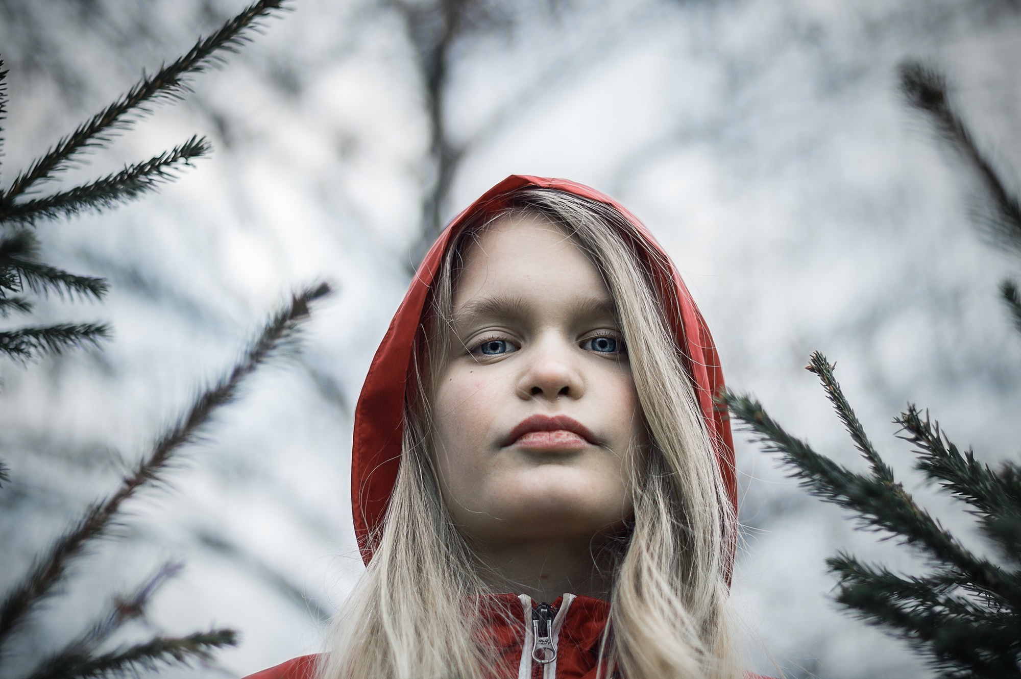 Portrait of the teenager in a red jacket