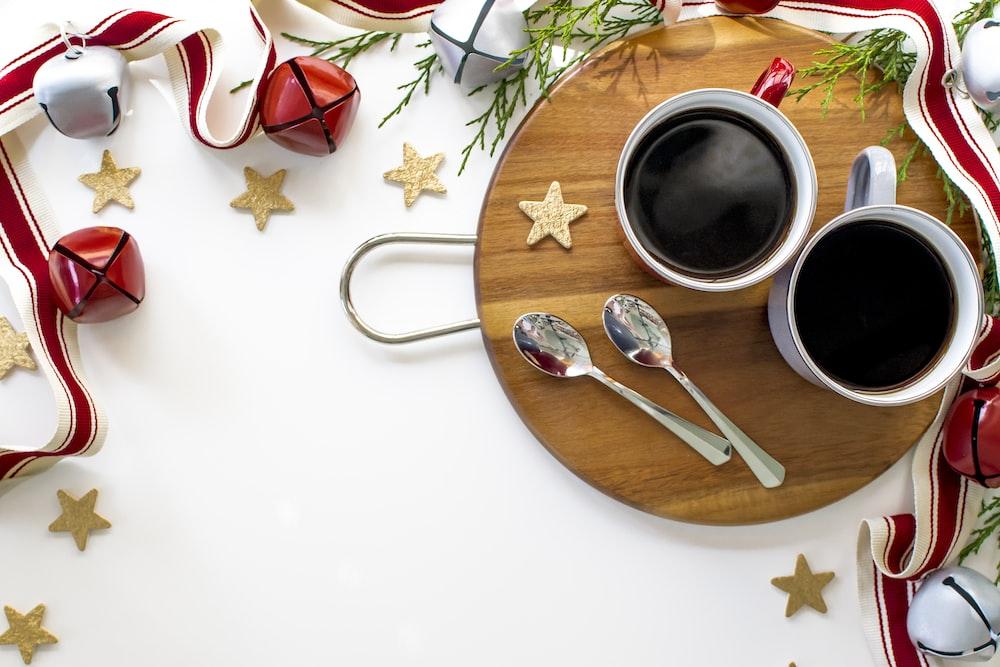 stainless steel fork beside white ceramic mug on brown wooden round plate