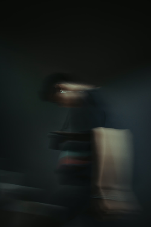 man in black shirt and black pants