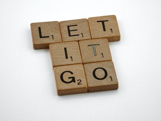 scrabble, scrabble pieces, lettering, letters, wood, scrabble tiles, white background, words, type, typography, design, layout, let it go, forgive, forgiveness, obsession, frozen, disney, move on, regret, despair,
