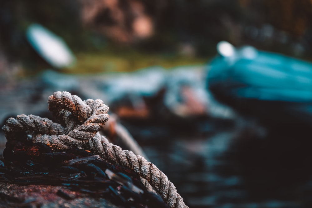 brown rope on body of water