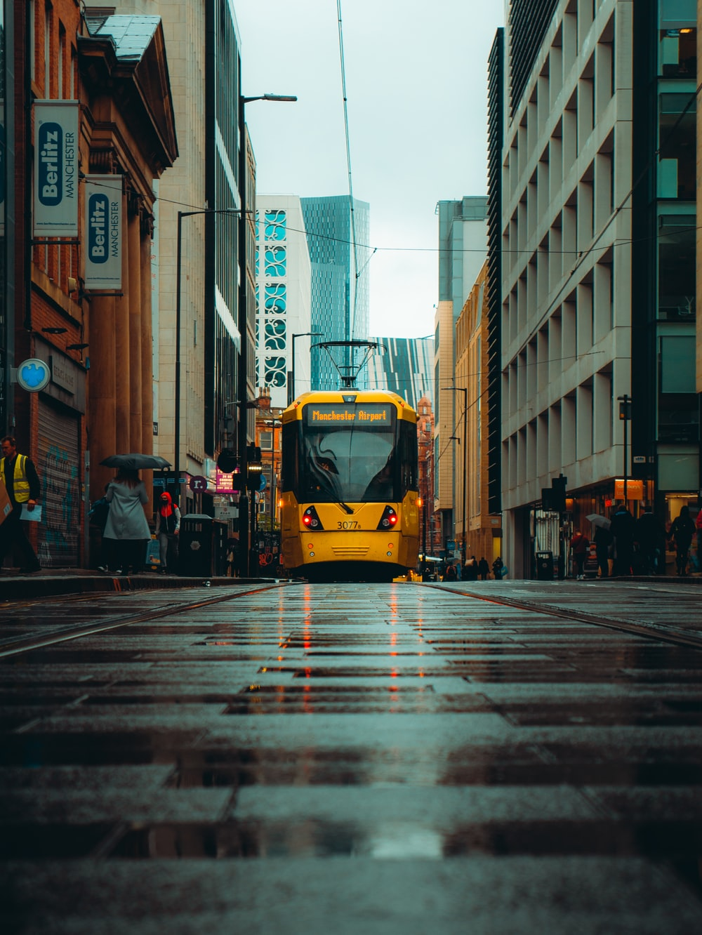 yellow bus on the street during daytime