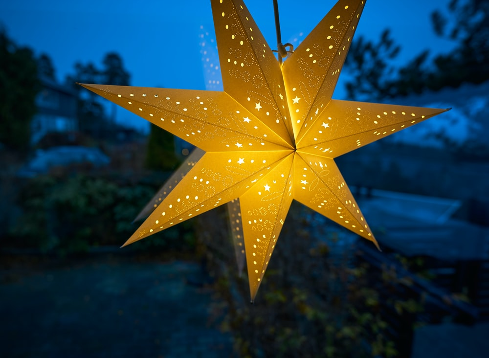 yellow star ornament on blue body of water during daytime