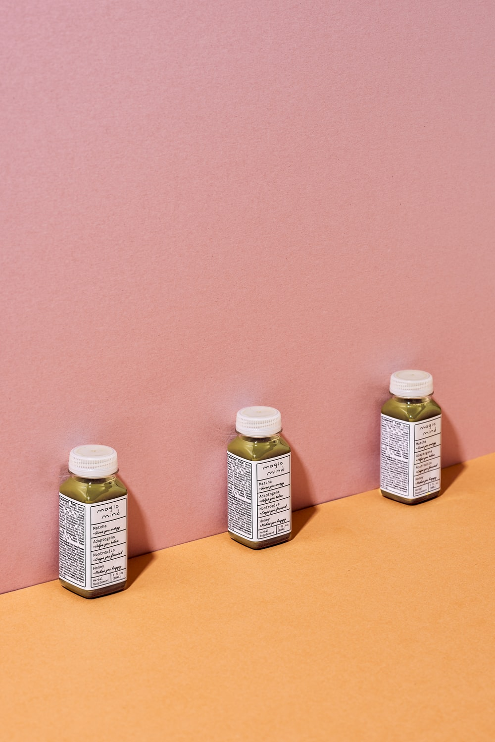two white plastic bottles on brown table