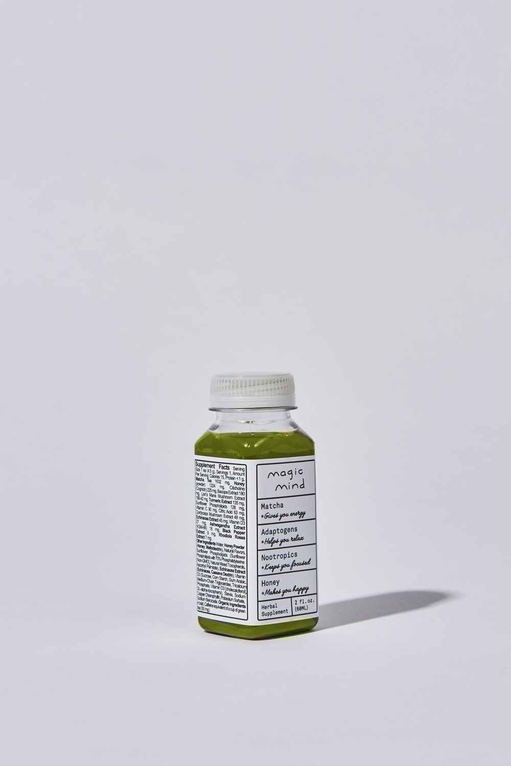 white and green labeled bottle