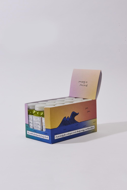 white and blue cardboard box