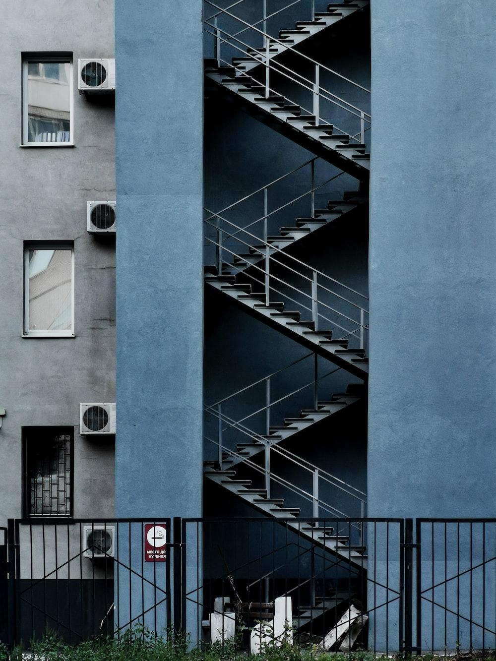 blue concrete building with white metal railings