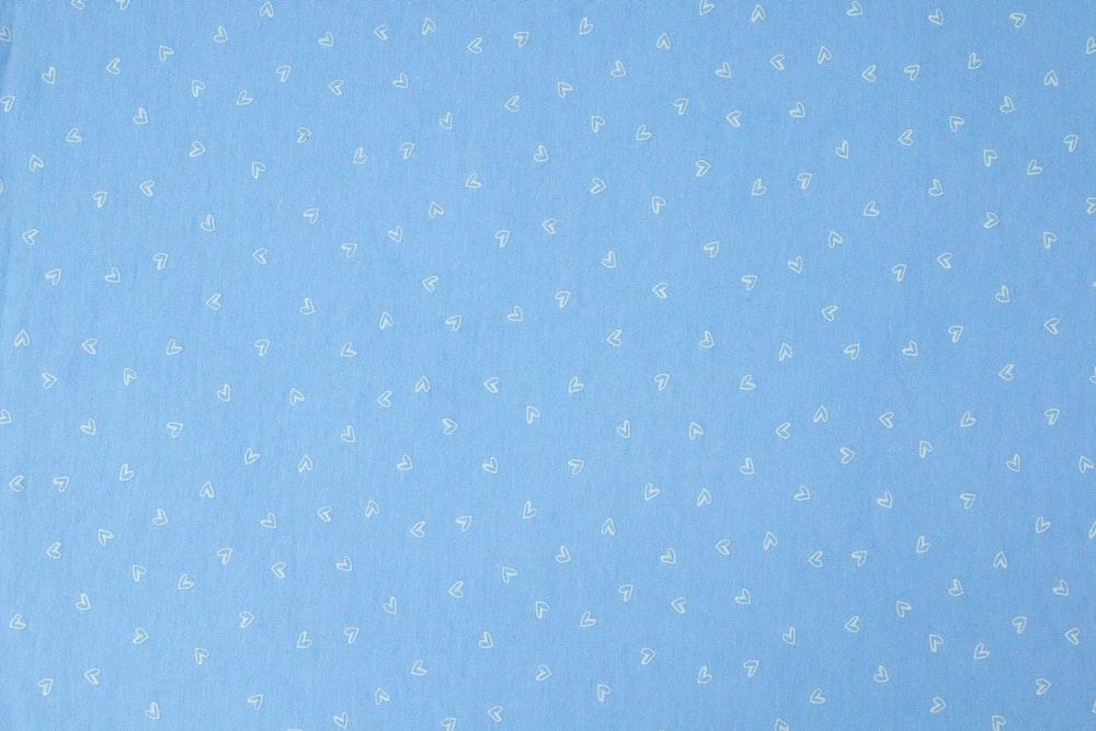 blue and white polka dot textile
