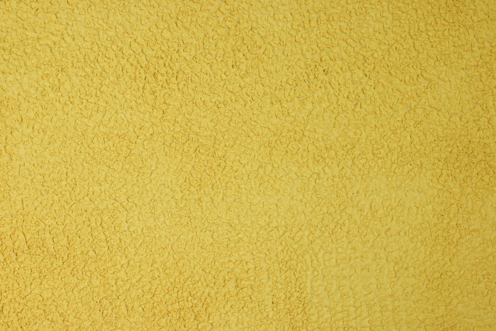 yellow wall paint in close up photography