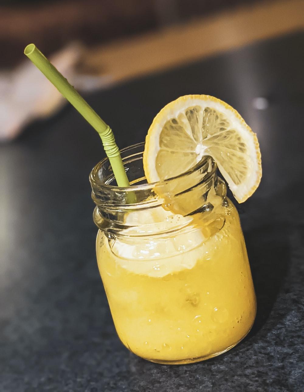 yellow juice in clear glass jar