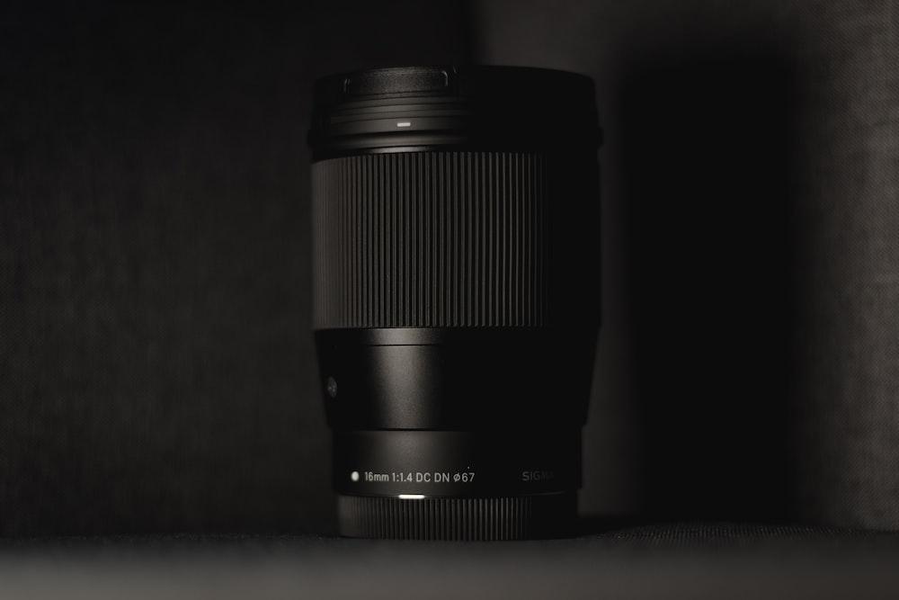 black camera lens on gray surface