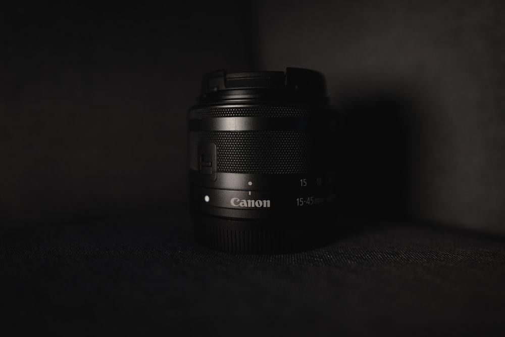 black camera lens on black surface