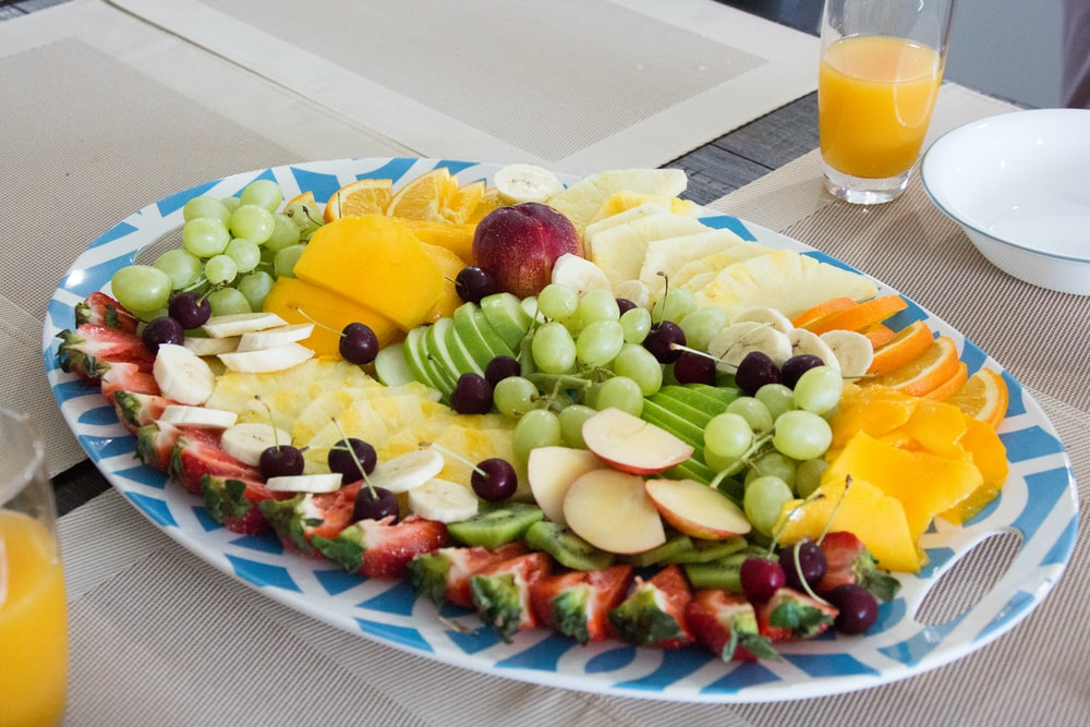 sliced fruits on white ceramic plate
