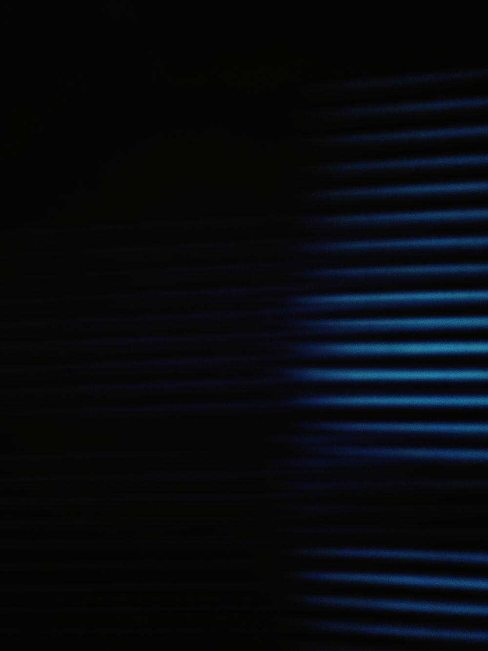 white window blinds in dark room