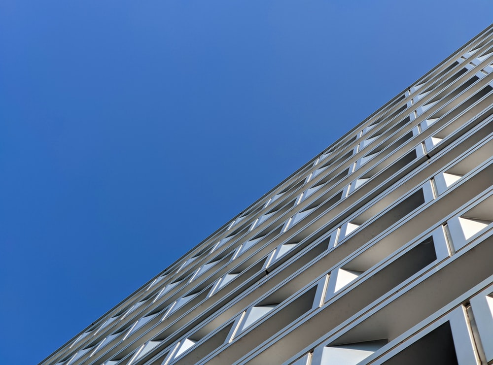 white concrete building under blue sky during daytime