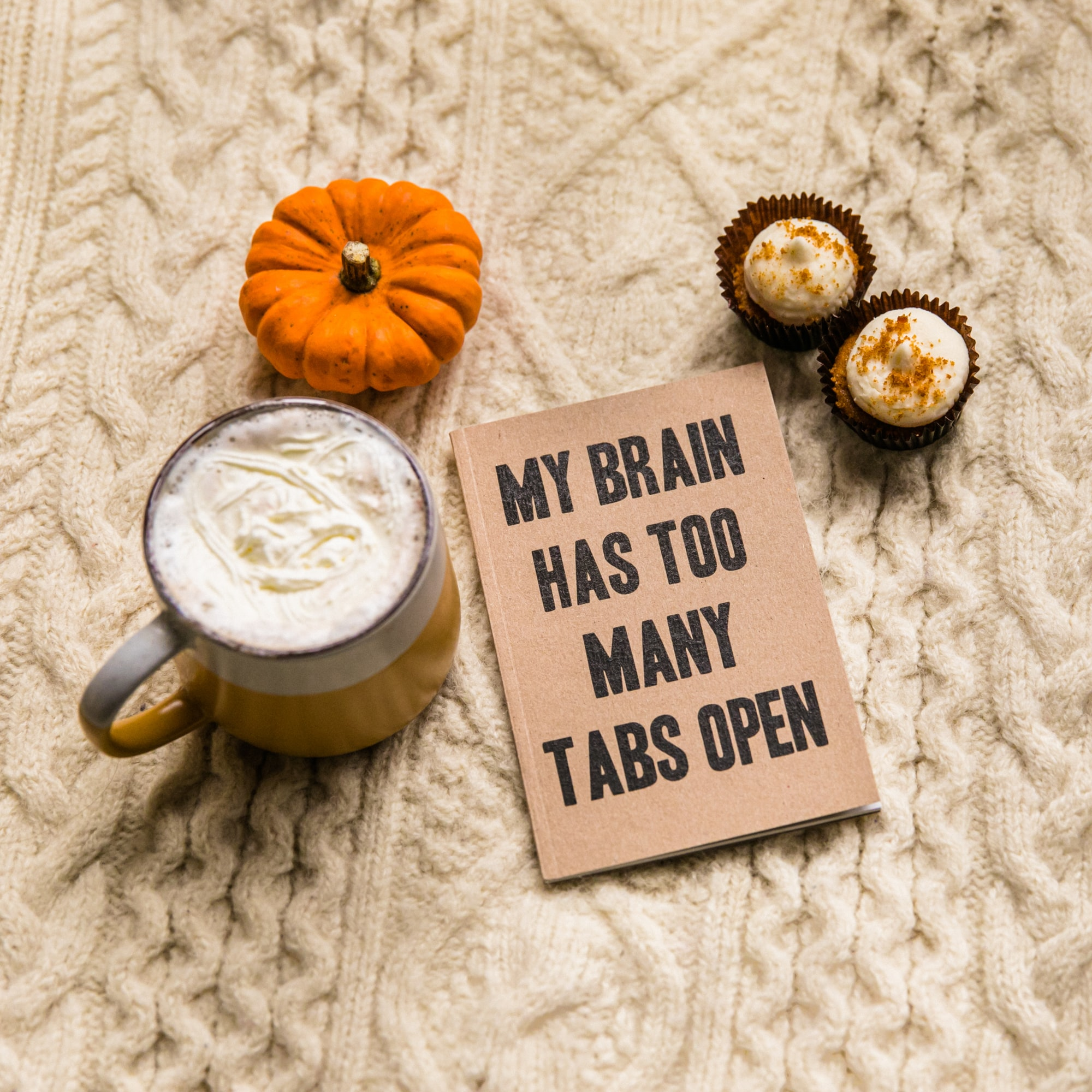 My brain has too many tabs open notebook alongside a pumpkin, cupcakes and a mug. Part of the Fireside in Autumn Collection.