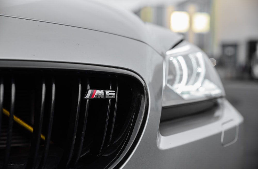 white and black car in close up photography